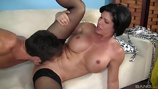 Hot mature keeps it deep in her cunt while moaning and rubbing her titties