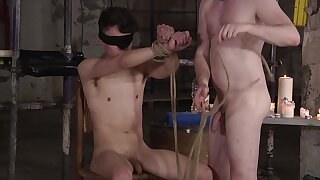 BDSM fetish video relative to a blindfolded gay dude being pleasured