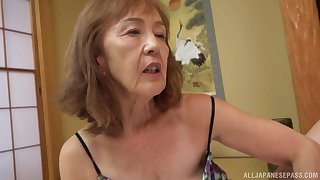 Asian milf Asano Taeko masturbates using her dildo with an increment of a dirty mind