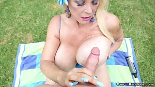 Mature cum lover in the air massive knockers jerks off a dick in POV