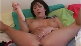 Hot milf masturbating almost dildo and squirt a lot
